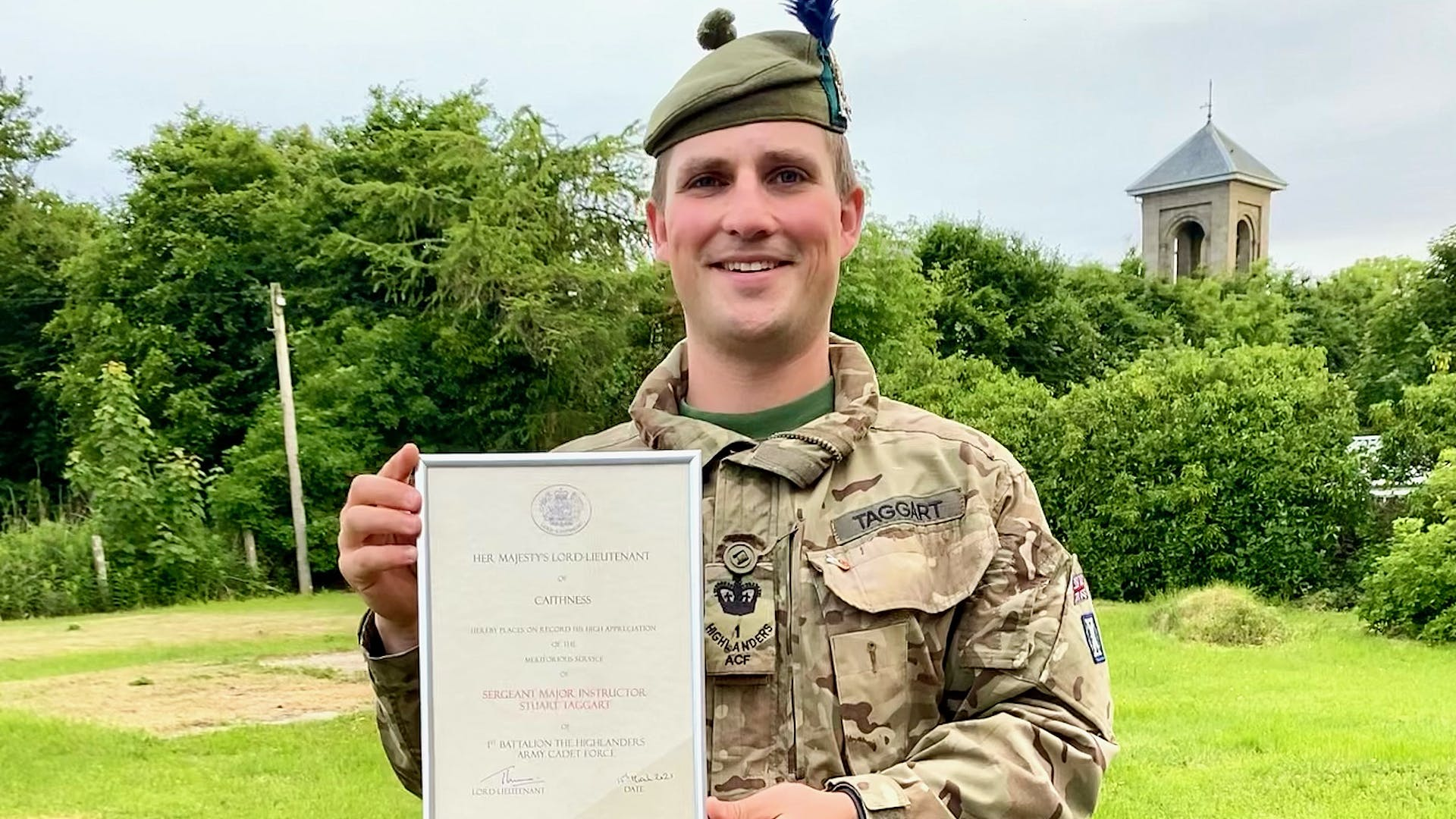 SMI Taggart with his Lord Lieutenants Certificate of Meritorious Service