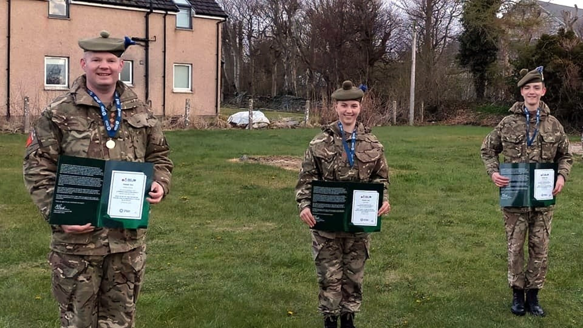 L R Halkirks Capt Stephen Mezals L Cpl Sarah Booth and L Cpl Callum Prideaux with their Guinnes World Record Certificates
