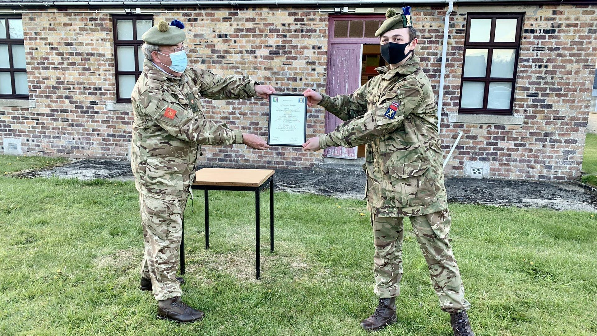 Sgt Keoni Jones right receiving his SCIC Certificate from Major Mac Lean Company Commander Caithness Company