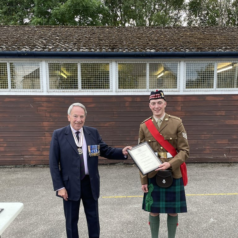 Sgt Samuel Stubbs right receiving his certificate if appointment from Vice Lord Lieutenant Douglas Young