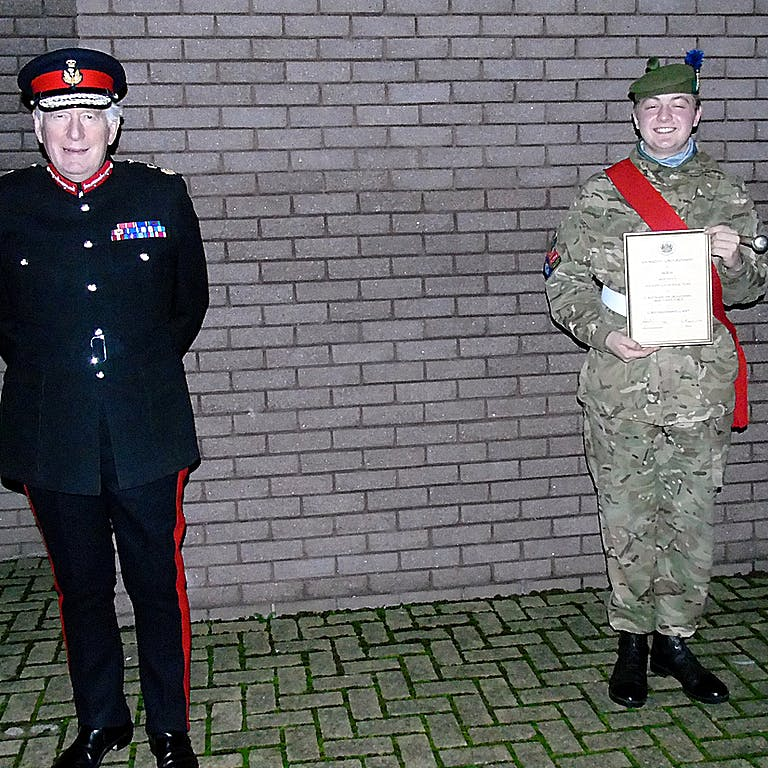 Maj Gen Munro CBE LVO the Lord Lieutenant of Moray left and Sgt Bialkowski right with his certificate of appointment