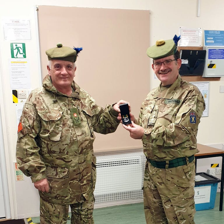 Major Raymond Cameron left receiving the Cadet Force Medal last week by the Battalions Commandant Col Mike Mac Donald