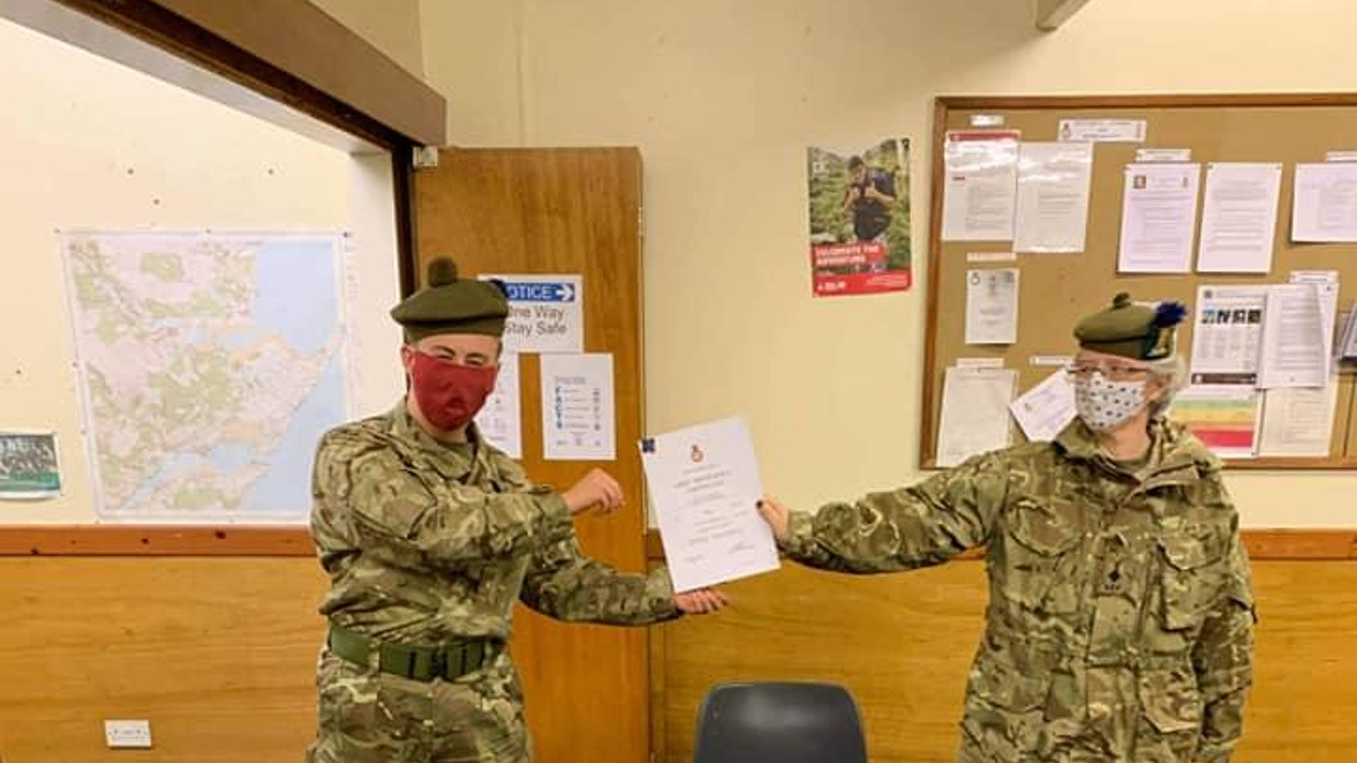 Cdt Calum Roberts left being awarded his Basic Certificate and Badge by Detachment Commander Lt Lorraine Wright