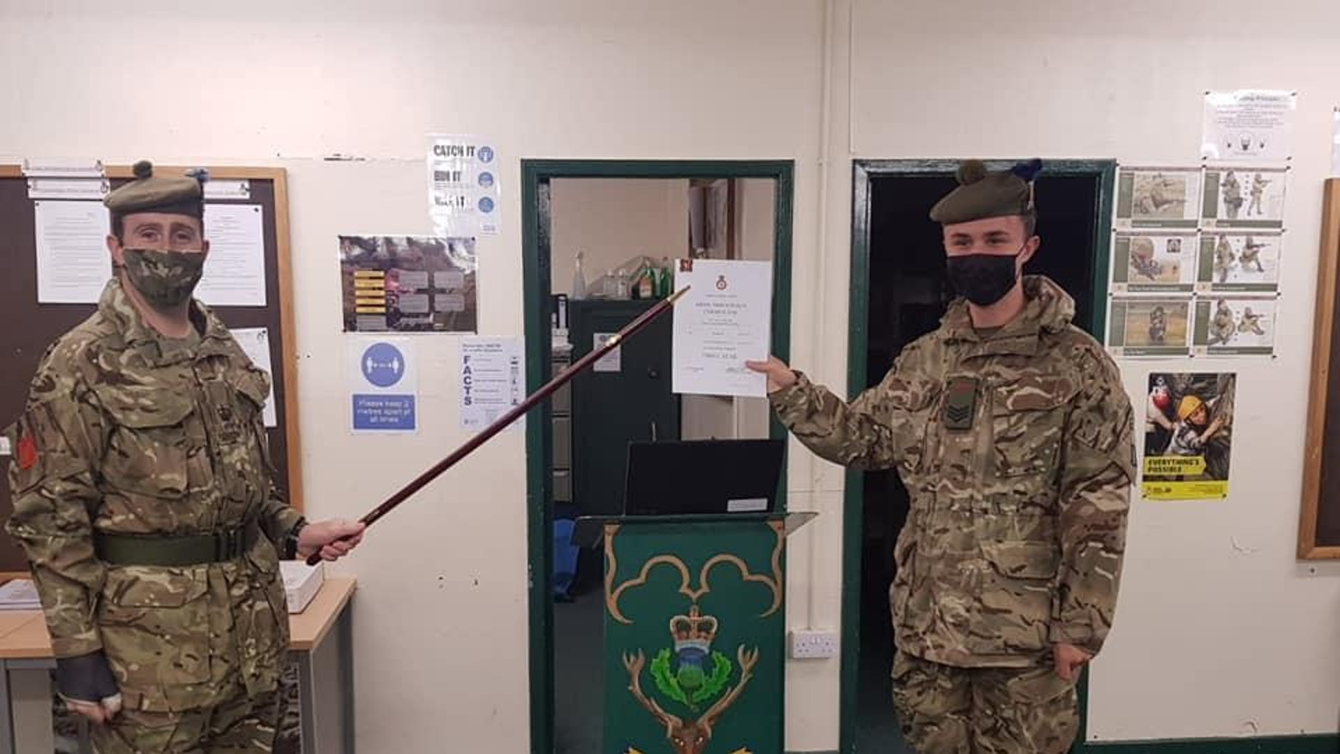 Sgt Lewis Squire right being awarded his 3 Star by Detachment Commander CSMI Mac Iver
