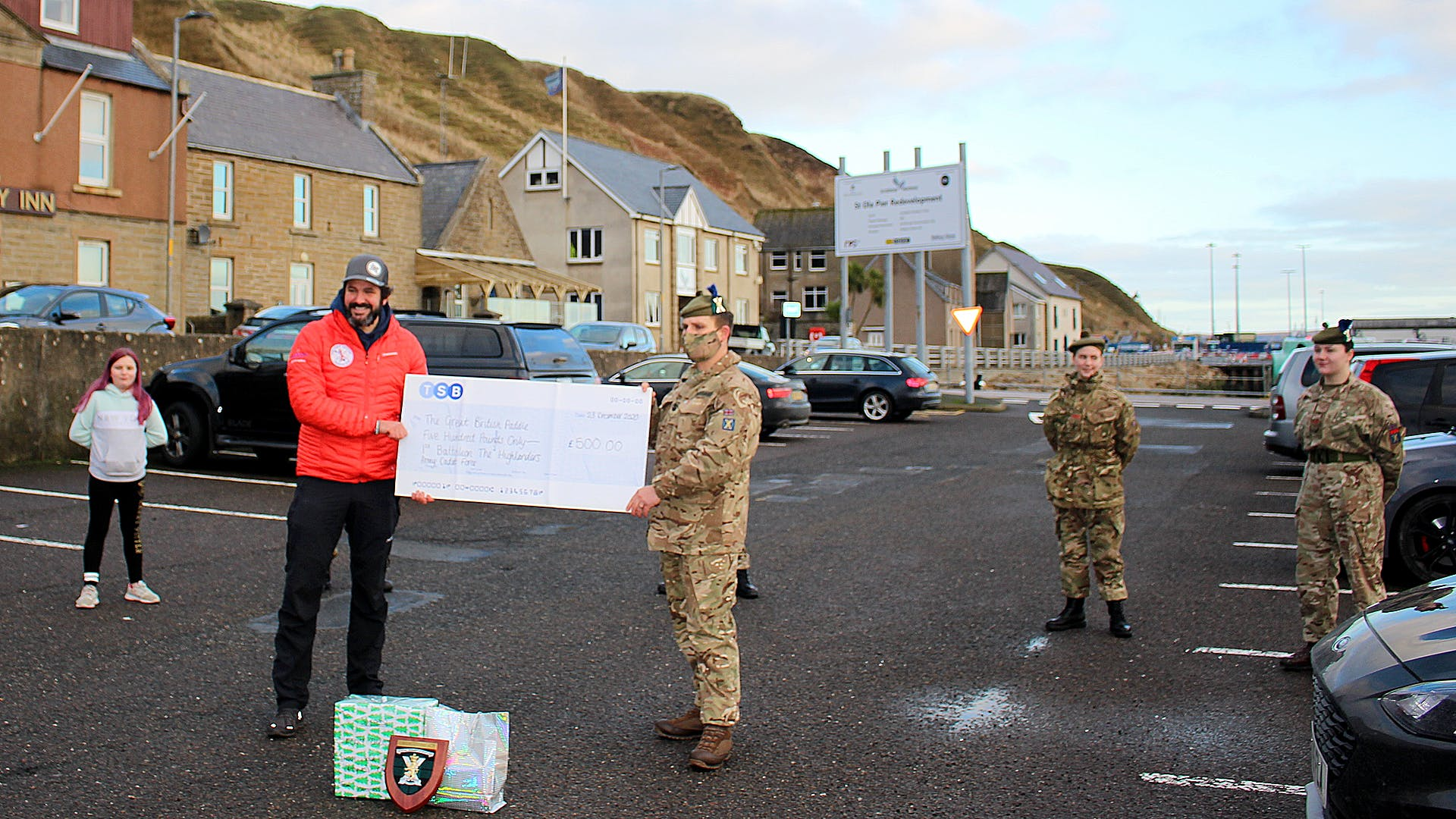 SMI Taggart right presenting Jordan with a 500 donation and a Caithness Care Package alongside cadets who attended to lend support
